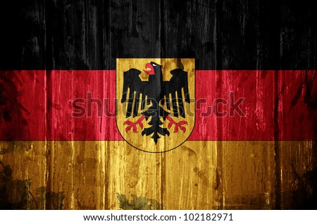 German flag overlaid with grunge texture - stock photo