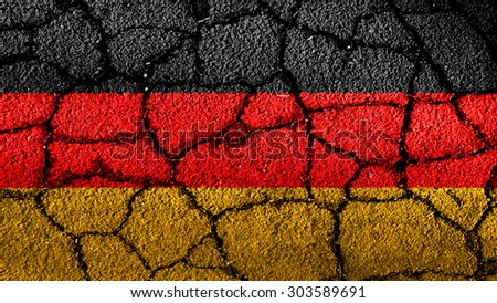 German flag painted on cracked earth, ground, street texture - stock photo