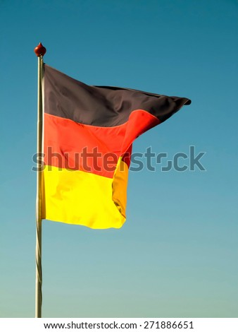 German flag pole pointing direction on clear sky  - stock photo