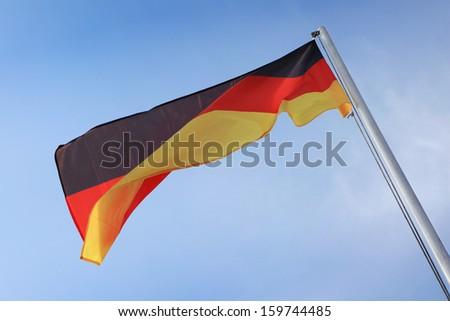 German Flag waving on wind. - stock photo