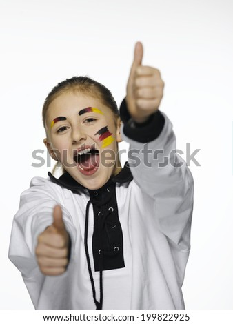 German football fan with thumbs up sign - stock photo