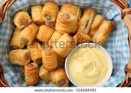 German frankfurter sausages in puff pastry with mustard sauce - stock photo