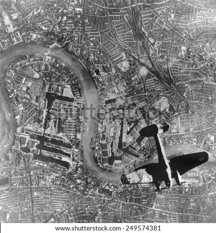 German Heinkel 111 bomber over London. Below is the River Thames and Tower Bridge. German photo taken Sept. 7, 1940 during first days of World War 2. - stock photo