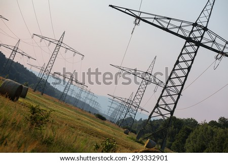 german high voltage pylons - stock photo