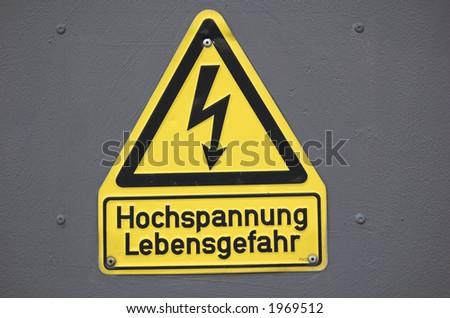 German hight-voltage sign - stock photo