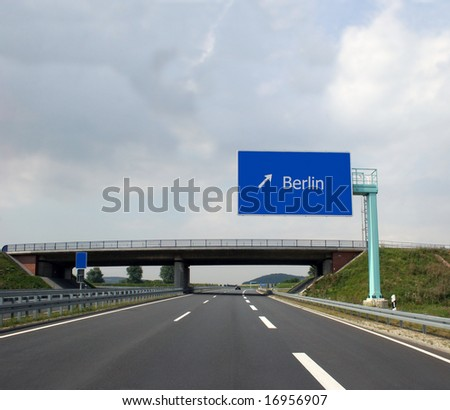 German highway (Autobahn) and direction sign to the captital Berlin - stock photo