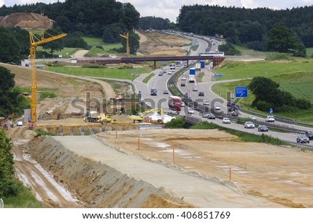 german highway under construction with trucks and digger - stock photo
