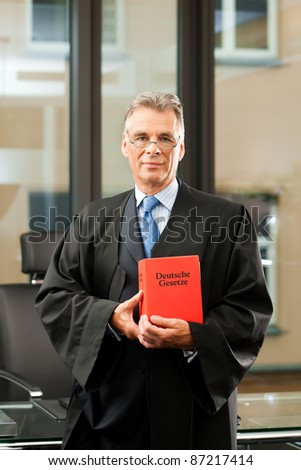 German Lawyer with civil law code in a court room - stock photo