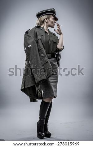 German officer in World War II, reenactment, soldier beautiful woman - stock photo
