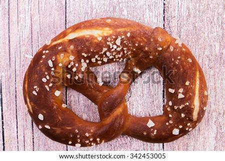 German pretzel sprinkled with coarse sea salt - stock photo