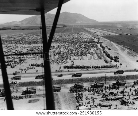 German prisoner of war camp west of Mateur, Tunisia. In the background is Hill 609 (Djebel Tahent), the linchpin of German defenses in the final battle for North Africa. - stock photo