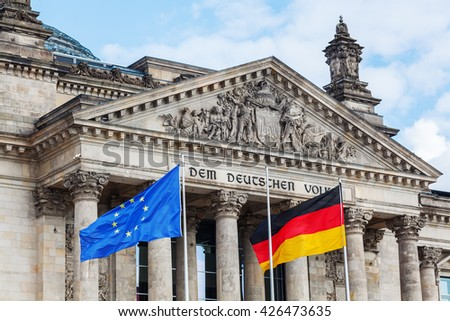 German Reichstag in Berlin, Germany, with national and EU flag