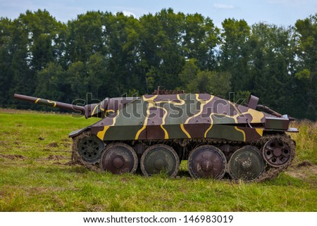 German self-propelled artillery installation of times of World War II, standing in a field near the forest