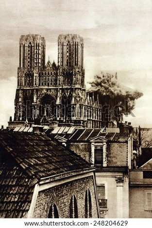 German shell bursting on Rheims Cathedral in WW1. Sept. 20, 1914. The French held Rheims during the Battle of the Marne.