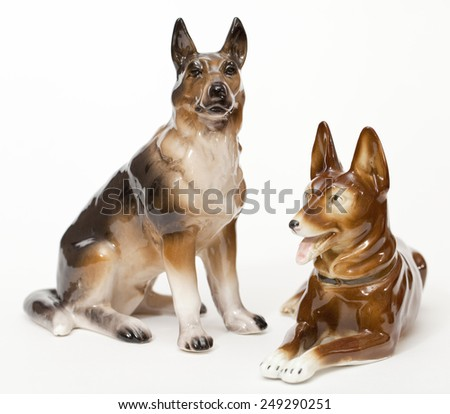 German Shepherds. Ceramic figurine, dog breed isolated on white - stock photo