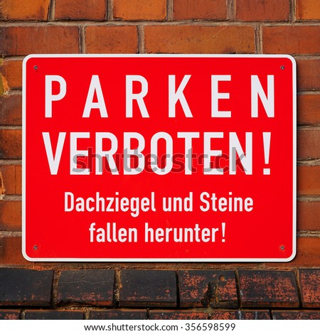 german sign that says No parking, roof tiles and stones fall down