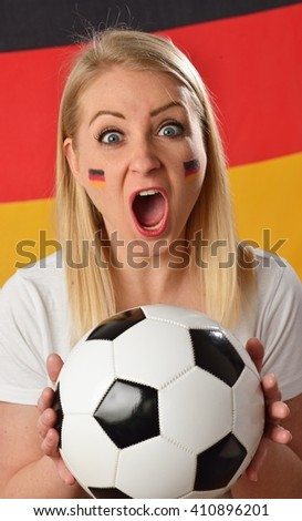 German soccer fan cheers football team in the national colors. MANY OTHER PHOTOS FROM THIS SERIES IN MY PORTFOLIO. - stock photo