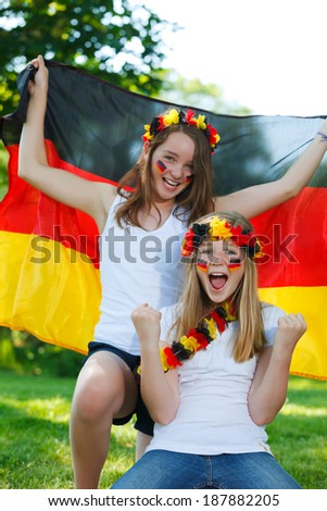 german soccer fans cheering outdoor - stock photo