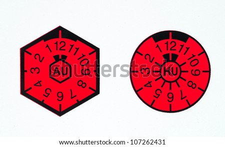 German TÃ?Â?V-seal and AU-badge - stock photo