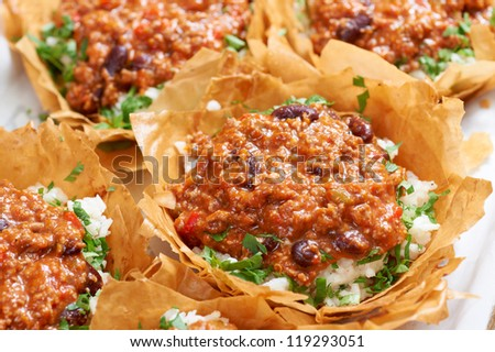 German tart dish with rice and tomato sauce in mille-feuille wrapper