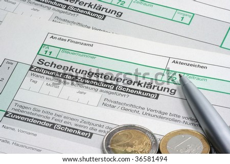 German Tax Gift Policy / Tax Form 'Schenkungssteuererkl�¤rung' with euro coins and ballpoint pen