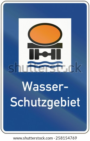German traffic sign prohibiting thoroughfare of vehicles transporting goods dangerous to water reserves. Wasserschutzgebiet means water protection area. - stock photo