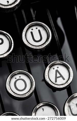 german umlauts on an old typewriter. symbolic photo for communication in former times - stock photo