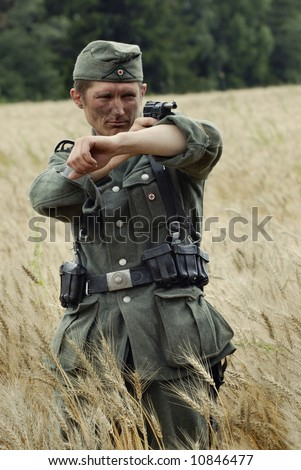 German WW2 infantery soldier aiming his pistol, Russia 1941