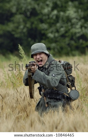 German WW2 infantery soldier with captured russian rifle, assaulting - stock photo