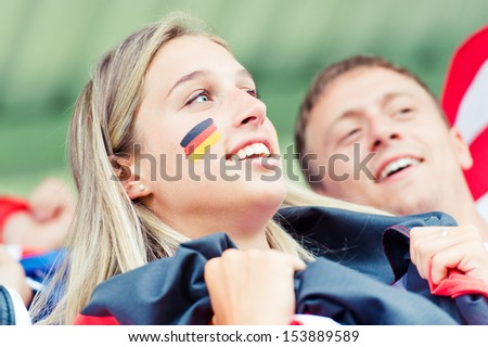 German young supporter at the stadium during the match