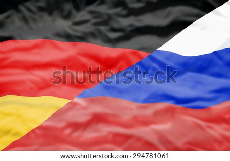 Germany and Russia mixed flag. Wavy flag of Germany and Russia fills the frame. - stock photo