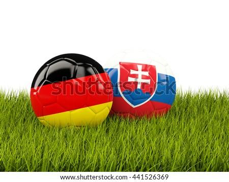 Germany and Slovakia soccer balls on grass. 3D illustration - stock photo