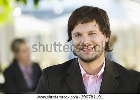 Germany, Bavaria, Upper Bavaria young businessman in beer garden