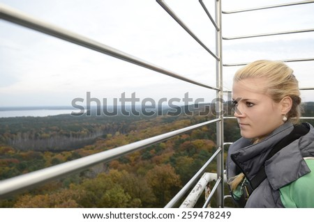 Germany, Berlin, young woman on viewing tower - stock photo