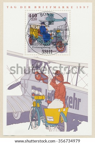 GERMANY - CIRCA 1997: A first day of issue postmark printed in Bonn, shows postal airplane and bicycle, Souvenir Sheet, circa 1997 - stock photo