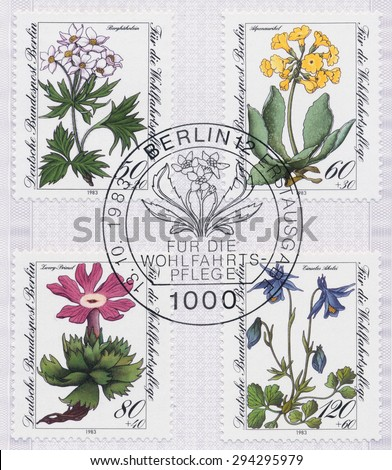 GERMANY - CIRCA 1983: A  first day of issue postmark printed in Germany, shows Flower Type of Germany: Mountain wildflower, Alpine auricula, Little primrose, Einseles aquilegia, circa 1983 - stock photo