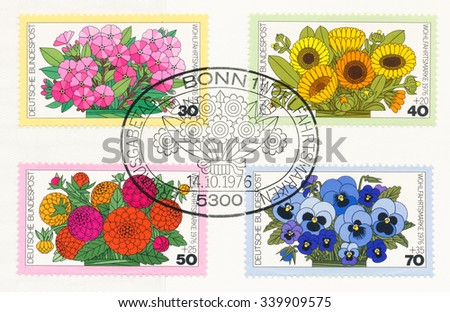 GERMANY - CIRCA 1976: A  first day of issue postmark printed in Germany, shows Flowers: Phlox, Marigolds, Dahlias, Pansies, circa 1976 - stock photo