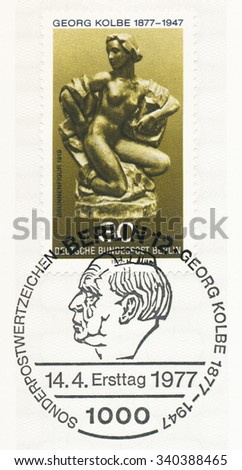 GERMANY - CIRCA 1977: A  first day of issue postmark printed in Germany, shows Fountain by Georg Kolbe (1877-1947), sculptor, circa 1977 - stock photo