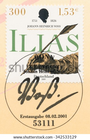 GERMANY - CIRCA 2001: A  first day of issue postmark printed in Germany, shows hand with pen, Johann Heinrich Voss (1751-1826), Translator Greek Classics, circa 2001 - stock photo