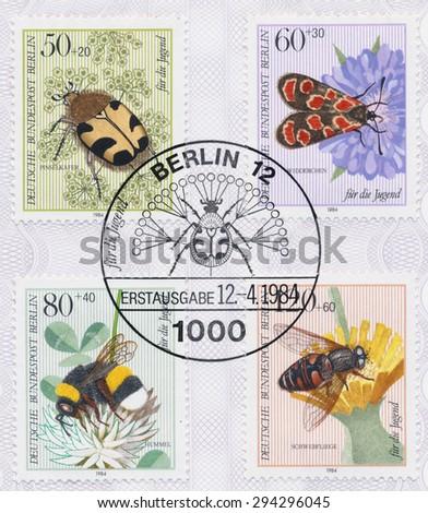 GERMANY - CIRCA 1984: A  first day of issue postmark printed in Germany, shows Insect Type: Trichius fasciatus, Agrumenia carniolioa, Bombus terrestris, Eristalis tenax, circa 1984 - stock photo