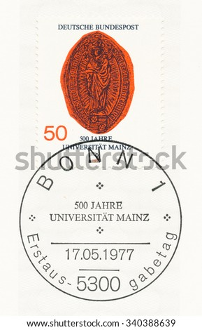 GERMANY - CIRCA 1977: A  first day of issue postmark printed in Germany, shows Madonna, Oldest Rectors Seal, Mainz University, 500th anniv., circa 1977 - stock photo