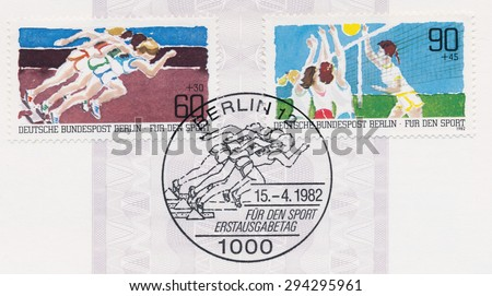 GERMANY - CIRCA 1982: A  first day of issue postmark printed in Germany, shows Sprinting, Volleyball, circa 1982 - stock photo