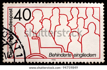GERMANY - CIRCA 1974: A post stamp printed in Germany integration of disabled, circa 1974 - stock photo