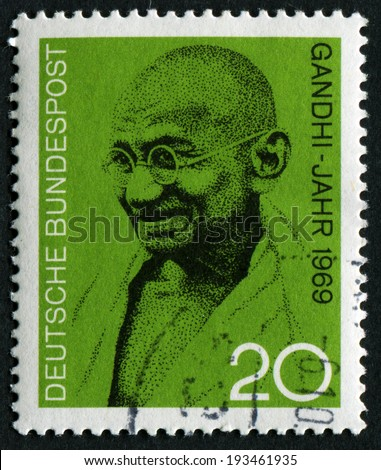 GERMANY - CIRCA 2004: A postage stamp printed in Germany showing Mohandas Karamchand Gandhi, circa 2004 - stock photo