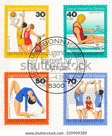 GERMANY - CIRCA 1976: A  postmark printed in Germany, shows basketball , rowing , Gymnastics, womens, volleyball, Youth training for Olympic Games. Surtax was for benefit of young people, circa 1976 - stock photo