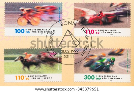 GERMANY - CIRCA 1999: A postmark printed in Germany, shows Racing Sports (Bicycles, Cars, Horses, Motorcycles), circa 1999 - stock photo