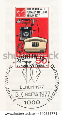 GERMANY - CIRCA 1977: A postmark printed in Germany, shows Telephones 1905 and 1977, International Broadcasting Exhibition, Berlin, Aug. 26-Sept. 4, and centenary of telephone in Germany, circa 1977 - stock photo