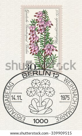GERMANY - CIRCA 1975: A postmark shows Erica carnea (winter heath, winter flowering heather, spring heath, alpine heath, E. herbacea, E. mediterranea), , Series Alpine Flowers, circa 1975 - stock photo