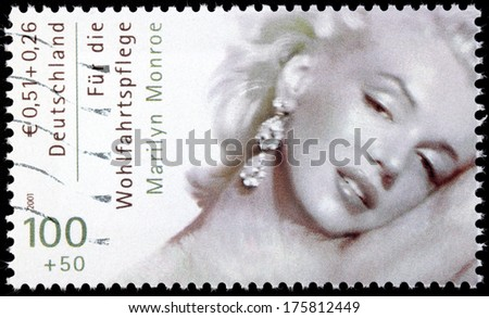 GERMANY - CIRCA 2001: A stamp printed by GERMANY shows image portrait of famous American actress, model and singer Marilyn Monroe (1926-1962), circa 2001 - stock photo