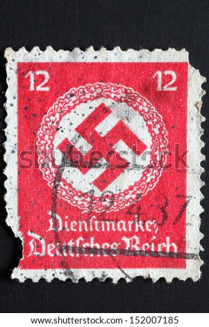 GERMANY - CIRCA 1942: A stamp printed by the fascist Germany Post shows a swastika in a garland, circa 1942 - stock photo